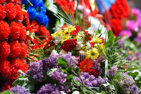 unknown age: Flowers and wreath laying in honor of the celebration of the victory. Celebrating the victory of May 9.