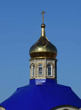 kuban: Domes of an Orthodox church. Gold-plated dome, orthodox crosses and blue roof.