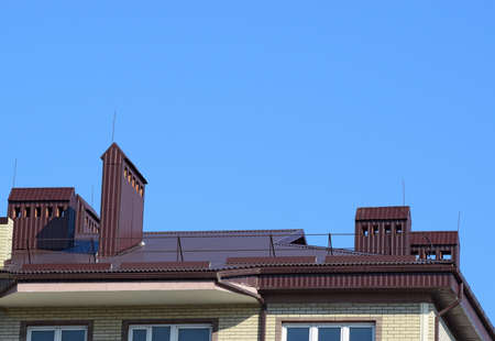 roof profile: The roof of a multistory building. The roof of the metal sheets, equipped with overflow and exhaust pipes.