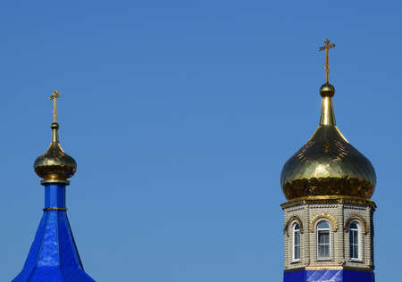 christmas cross: Domes of an Orthodox church. Gold-plated dome, orthodox crosses and blue roof.
