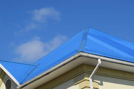 trussing: Blue roof metal sheets. Modern types of roofing materials.