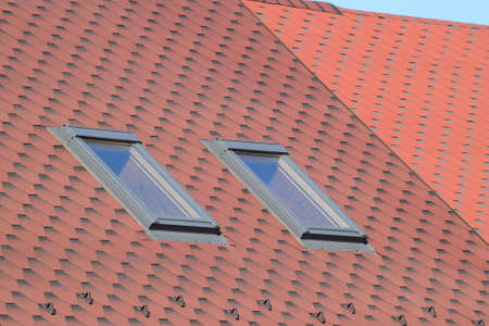 roof profile: Decorative metal tile on a roof. Types of a roof of roofs.