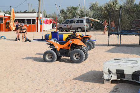 quad: Russia, Achuevo - August 2, 2015: A small quad bike rentals. Rental services on the beach by the sea. Editorial