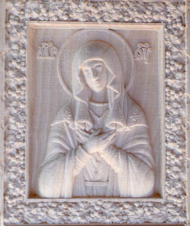 numerical: Carving on the machine with numerical control. Cut cutter machine icon of the Virgin Mary. Stock Photo