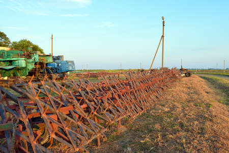 tine: Tine harrow. Agricultural machinery and equipment. Parking farm machinery. Stock Photo