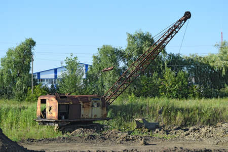 quarries: Old quarry near the dragline. Old equipment for digging the soil in canals and quarries.