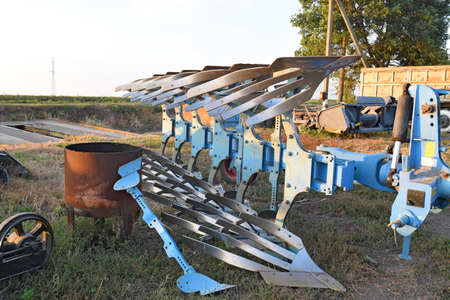 farm machinery: Rotary plow parked farm machinery. For plowing soil tractor equipment. Stock Photo