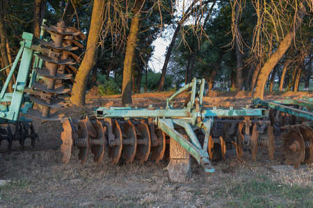 harrow: The disk harrow. Agricultural machinery for processing of the soil in the field.