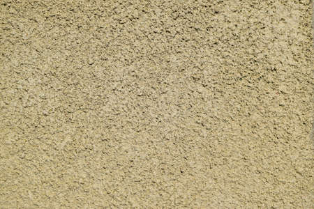 coverings: Texture of a wall from the made foam plaster. Types of external coverings of the building. Stock Photo