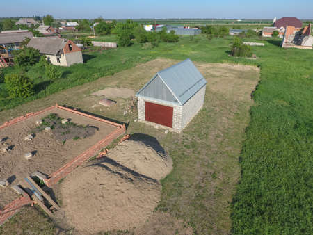 roof profile: Top view of the garage in a private plot of land. Private construction. Stock Photo
