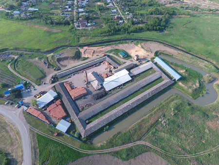 throughput: Brick production plant. Top view of a small factory for firing bricks.