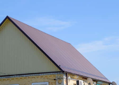 gable home renovation: Roof metal sheets. Modern types of roofing materials.