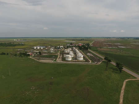 separation: Aerial view of oil storage tanks. Industrial facility for the storage and separation of oil. Stock Photo