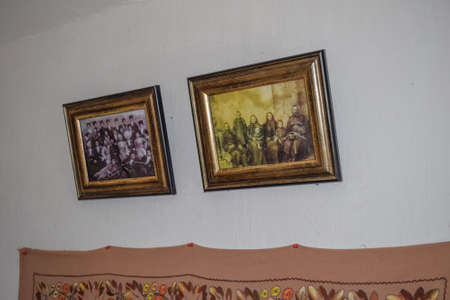 cossack: Russia, Ataman - 26 September 2015: Photos of the Cossacks and Cossack family on the whitewashed wall. Ethnic and Cultural Museum.