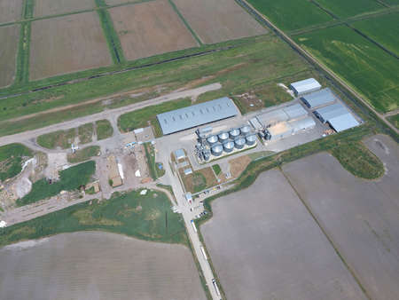 grain storage: Plant for the drying and storage of grain. Rice plant in the middle of fields. Top view.