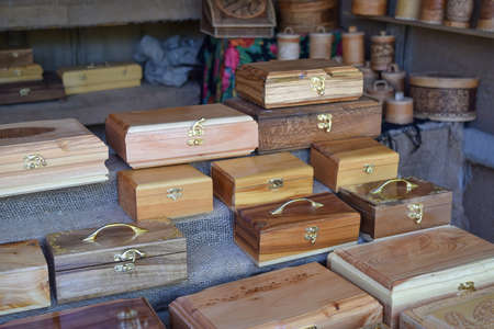 treated board: Wooden boxes on the counter. Wooden souvenirs in the form of boxes with locks.