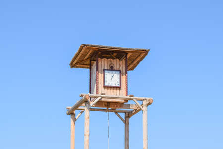 wooden clock: Russia, Ataman - 26 September 2015: The wooden clock tower. for time tracking in a village in the old days.