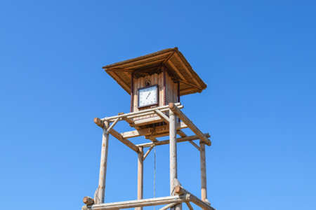 wooden clock: The wooden clock tower. for time tracking in a village in the old days. Stock Photo