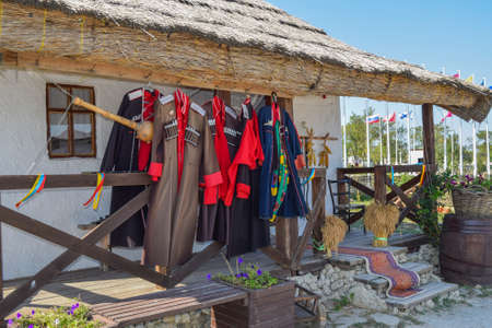 cossack: Russia, Ataman - 26 September 2015: Cossack upper uniforms hanging on the veranda. Drying Cossack form. Editorial
