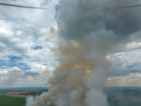 propellers: Quadrocopters propellers on the background of the smoke. Burning straw in the field. Stock Photo