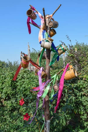 steins: Stick with hung at her beer steins and ribbons. Wish Tree. Stock Photo