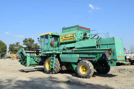 clarification: Russia, Poltavskaya village - September 6, 2015: Combine harvesters Don. Agricultural machinery.
