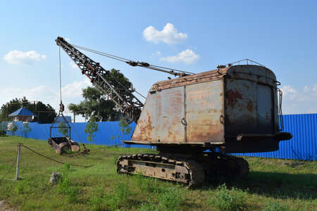 dragline: Old quarry near the dragline. Old equipment for digging the soil in canals and quarries.