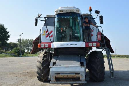 clarification: Russia, Poltavskaya village - September 6, 2015: Combine harvesters Torum. Agricultural machinery.