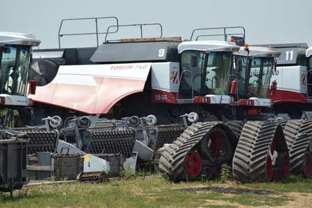 harvesters: Russia, Poltavskaya village - September 6, 2015: Combine harvesters Torum. Agricultural machinery.