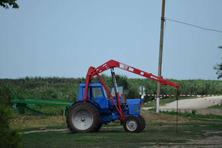 agricultural machinery: Russia, Temryuk - 15 July 2015: Tractor, standing in a row. Agricultural machinery. Parking of agricultural machinery. Editorial
