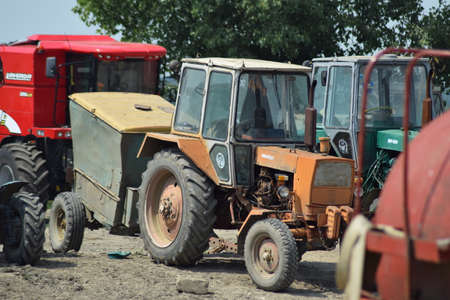 Russia, Temryuk - 15 July 2015: Tractor, standing in a row. Agricultural machinery. Parking of agricultural machinery. Editorial