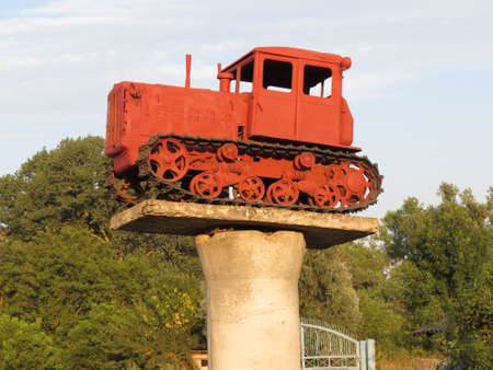 farm duties: Russia, Temryuk - 15 July 2015: Tractor on a pedestal. Monument agricultural machinery. Editorial