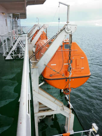 ship deck: Lifeboat on the industrial board. View ship deck edge.