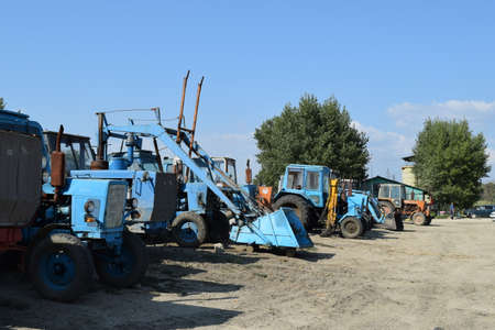 agricultural machinery: Tractor, standing in a row. Agricultural machinery. Parking of agricultural machinery.