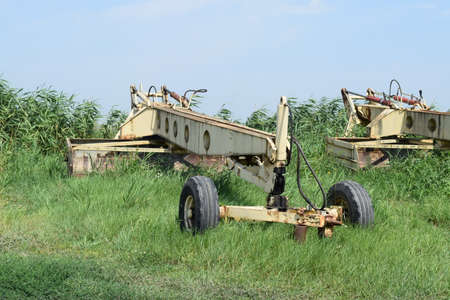 farm equipment: Auxiliary tow tractor. Parking farm equipment and accessories.