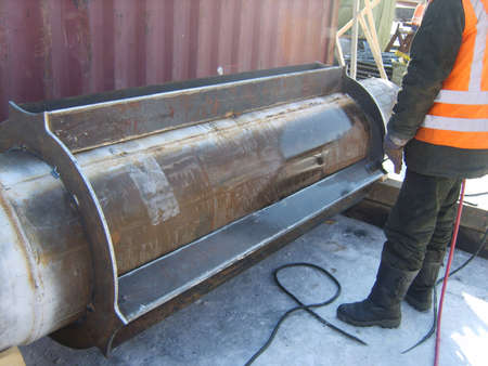 deconstruct: Welding of a dyuker in a cartridge. Strengthening of a design of the pipeline. Stock Photo