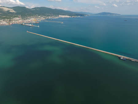 sea port: Top view of the bay Tsemess. The international sea port of Novorossiysk. Mol - building to stop the waves.