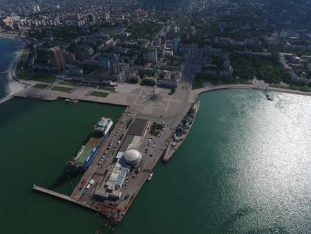 embankment: Top view of the marina and quay of Novorossiysk. Urban landscape of the port city. Stock Photo