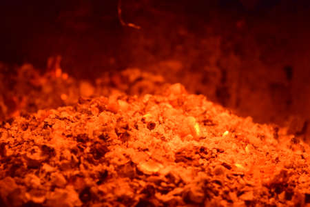 scorching: Hot coals in the stove. Red burned by heating the particles tree.