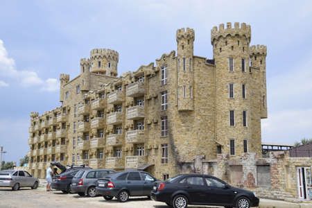 castle conditioning: Russia, Golubitskaya - July 20, 2016: The hotel building, covered with decorative stone. Multi-storey hotel with a decorative trim, which is called Dagestani stone. Editorial