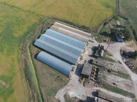 agricultural engineering: Top view of the hangars. Hangar of galvanized metal sheets for the storage of agricultural products and storage equipment. Stock Photo
