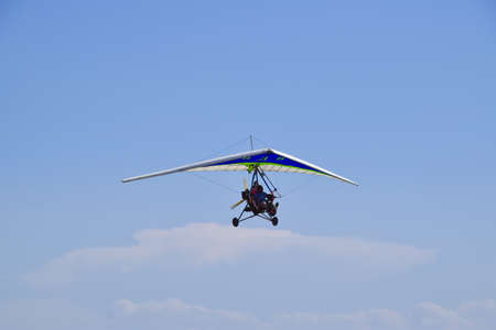airplane ultralight: Russia, Veselovka - September 6, 2016: Trike, flying in the sky with two people. Extreme Entertainment travelers.