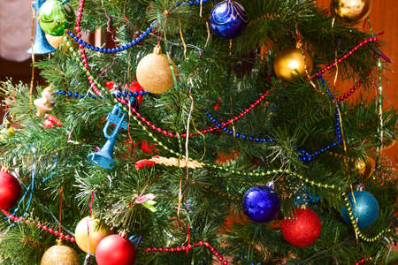 christmas toys and ornaments on the christmas tree tinsel balls and toys decorated fir - Christmas Tree Tinsel