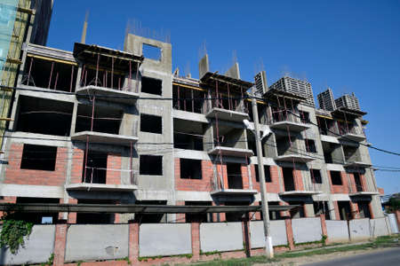 multistory: Construction of a multistory building. Installation of the concrete walls of the building. Stock Photo