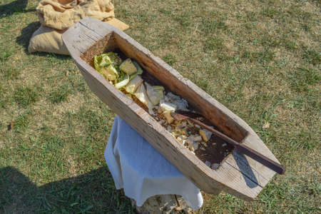 finer: Wooden trough for cutting cabbage. Antique household items in the village. Stock Photo