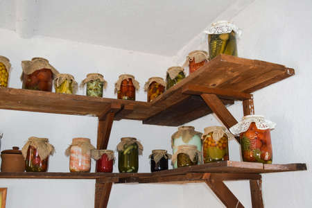 owning: House canned food from vegetables. Stocks of food of residents of the Russian village.