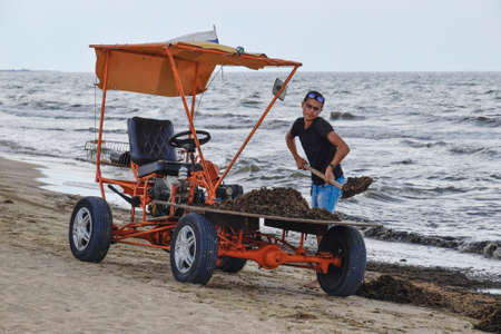 garbage collection: The car for garbage collection from the beach. Cleaning on the beach, clean beach from mud and waste.
