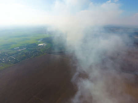 kuban: The smoke over the village. Clubs of smoke over the village houses and fields. Aerophotographing areas.