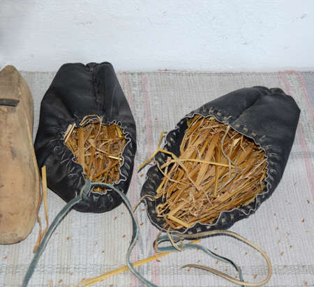 maintain: Leather sandals stuffed with hay to maintain the shape. Stock Photo