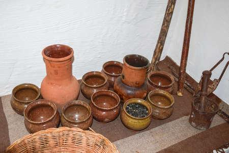 serving utensil: Shelves with standing on their utensils of porcelain and earthenware. Vintage kitchen utensils.